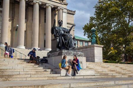 NEW YORK, USA - OCTOBER, 2015: Columbia University Library buildings with columns and Alma Mater statue