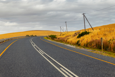 Curvy countryside road in South Africa in spring season Stock Photo