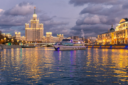 Moskva river night view and a touristic boat cruising