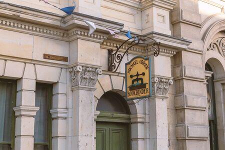 OAMARU, NEW ZEALAND - DECEMBER, 2017: Facade of old building and bookbinder advertisment sign