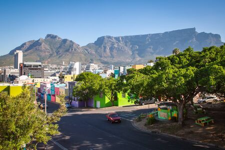 CAPE TOWN, SOUTH AFRICA - NOVEMBER, 2018: Bo Kaap district with colorful houses and Table Mountain view from the hill