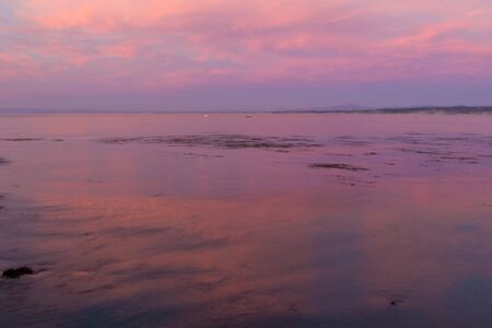 Amazing pink sunset over the bay in Monterey, California