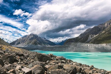 Turqouise Tasman Glacier Lake and Rocky Mountains of the Mount Cook National Park, New Zealand