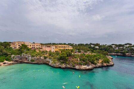 Beautiful bay of Cala Ferrera with turquoise water and villas in Cala dOr, Mallorca Banco de Imagens