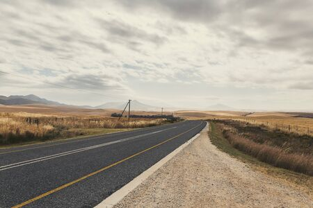 Curvy countryside road in South Africa in spring season Banco de Imagens
