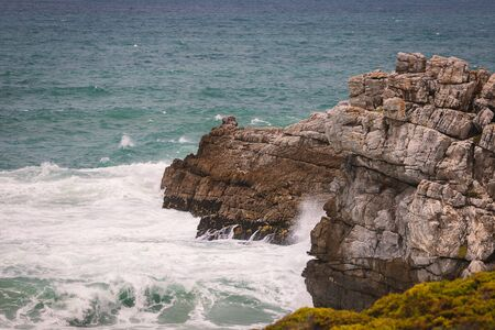 Rocky ocean coast of town of Hermanus, South Africa