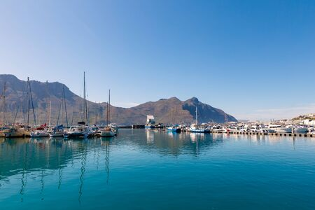 Hout Bay boats and mountain reflections morning view