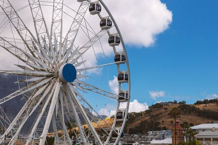 Ferris wheel and Table Mountain view at Waterfront in Cape Town