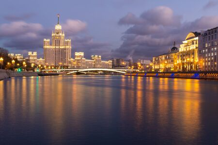 Moskva river night view with historical buildings and cloudy sky