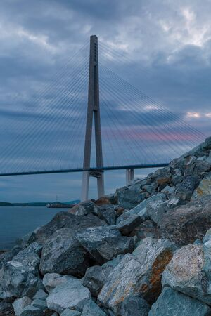 Evening view of long cable-stayed bridge in Vladivostok, Russia