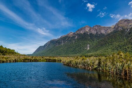 Huge mountains and lake in Fjordland National park in New Zealand Banco de Imagens