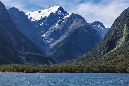 Huge snowy mountains view from Milford Sound in New Zealand South Island