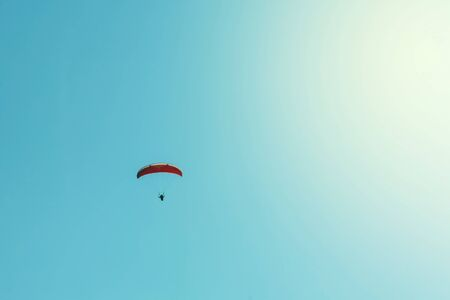 Paraglider and clear blue sky background Stock Photo