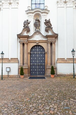 Strahov Monastery facade with a beautiful large door in Prague