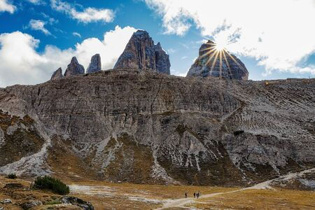 Stunning view of rocky mountains and cloudy sky in Tre Cime di Lavaredo park in Italy