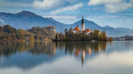 Morning view of famous lake Bled and small island with a church in Slovenia