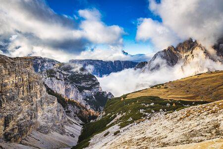 Rocky mountains in Italy with cloudy sky, Dolomites, Tre Cime di Lavaredo Banco de Imagens