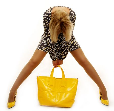 lovely blond woman with yellow bag on white background photo