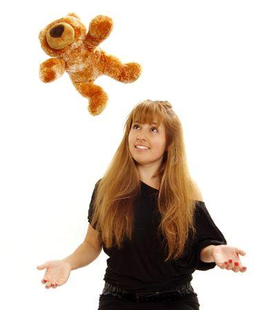 outstretching: Woman watching teddy bear