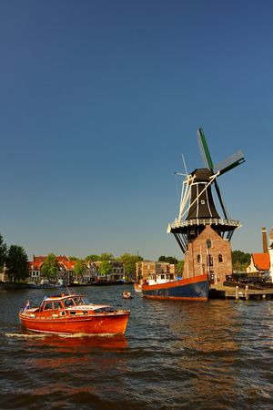 Dutch mill on the waterside photo