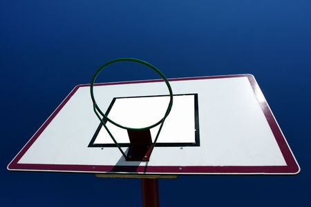 Basketball basket on blue sky background. photo