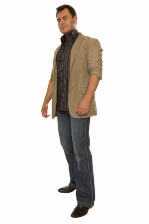 Young man standing half-tuned and smiling  photo