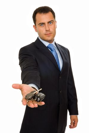 A businessman offering a bunch of car keys and car alarm system photo