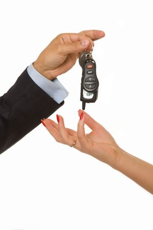 A man hands over a bunch of car keys and car alarm system to a woman photo