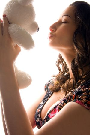 captivating: woman kissing a bear toy