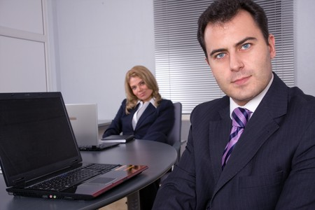 businessmeeting: Business meeting in modern office. In the foreground a businessman Stock Photo