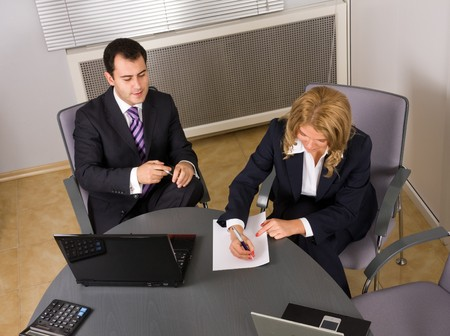 Two contemporary businesspeople at a meeting in the office photo