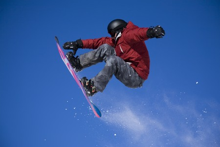 freestyle: snowboarder jumping high in the air
