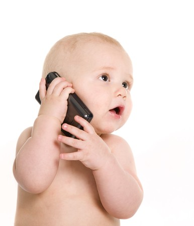 Portrait of pretty baby talking on mobile phone. Isolated over white Stock Photo - 4210737