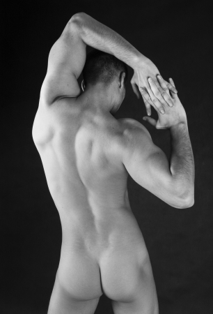 nude man: muscular torso of nude man. Black and white