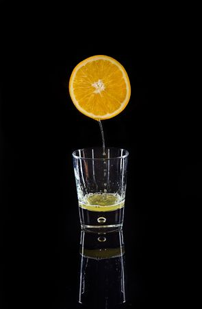 compressed orange isolated on a black background photo