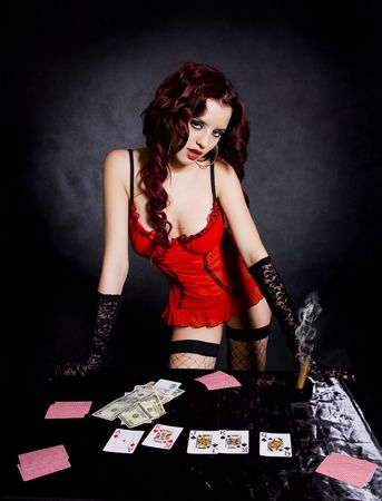 gambling pretty woman in beautiful lingerie. Over black background  Stock Photo - 4893471