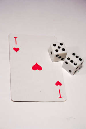 ace: the ACE of hearts and two dice