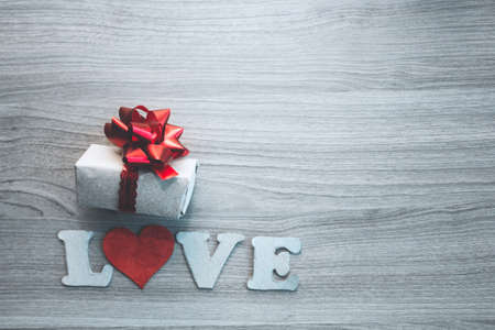 LOVE letters, cardboard heart and gift  box  with red bow. concept for Valentines day, romantic anniversary,love.