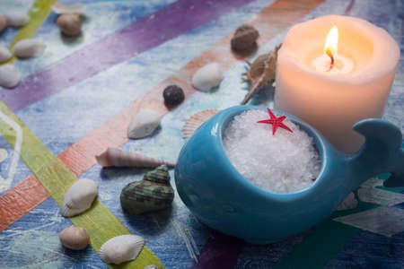 swimming candles: Spa concept. Seashells , candles and  sea salt Stock Photo