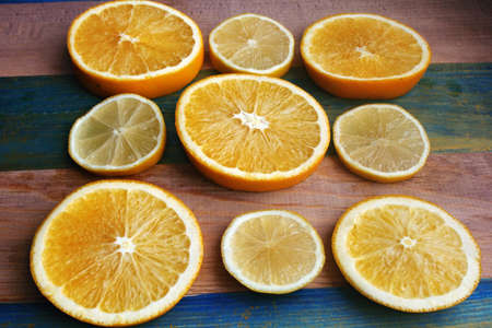 slices of lemon and orange on a wooden table