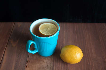 lemon tea in  blue cups on a wooden table Stock Photo