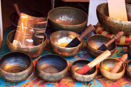 healing with sound: singing bowls on the market Stock Photo