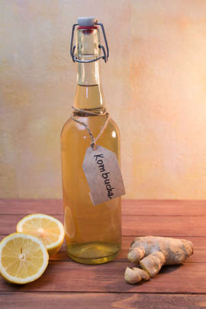 Kombucha tea with lemon and ginger in a vintage bottle with a kraft label
