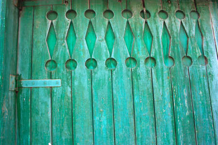 part old wooden shabby blue door on a farm Stock Photo