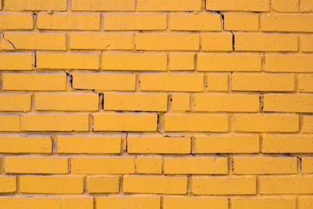 old brick wall: brick wall painted yellow for background Stock Photo