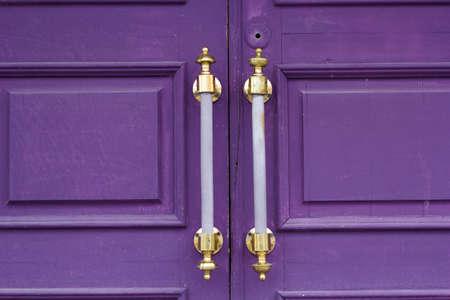 door knob: old massive wooden door closeup