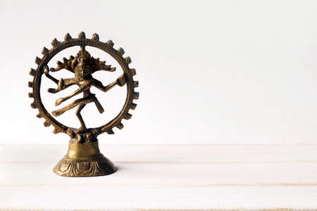 figurine Nataraja on a white background. copy space. Stock Photo