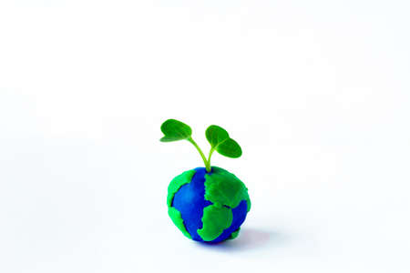 Earth clay with the sprout. ecological concept.