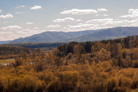 autumn landscape with forest on the background of the Ural mountains on a clear Sunny day