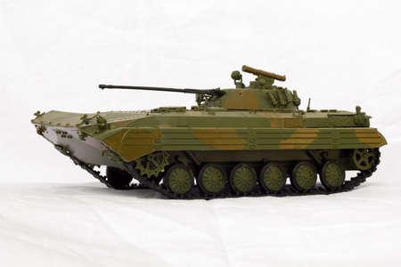 khaki: toy model tank on a white fabric background Stock Photo